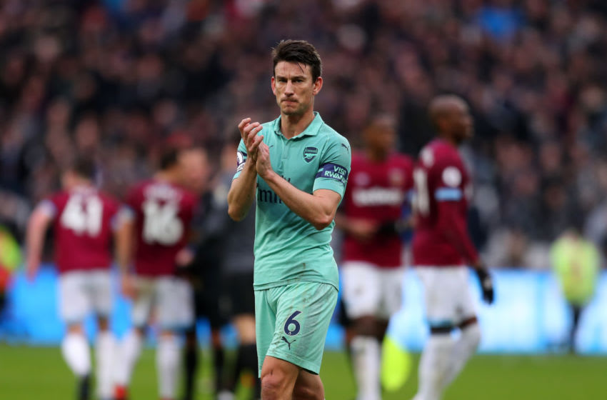LONDON, ENGLAND - JANUARY 12: Laurent Koscielny of Arsenal applauds after the Premier League match between West Ham United and Arsenal FC at London Stadium on January 12, 2019 in London, United Kingdom. (Photo by Catherine Ivill/Getty Images)