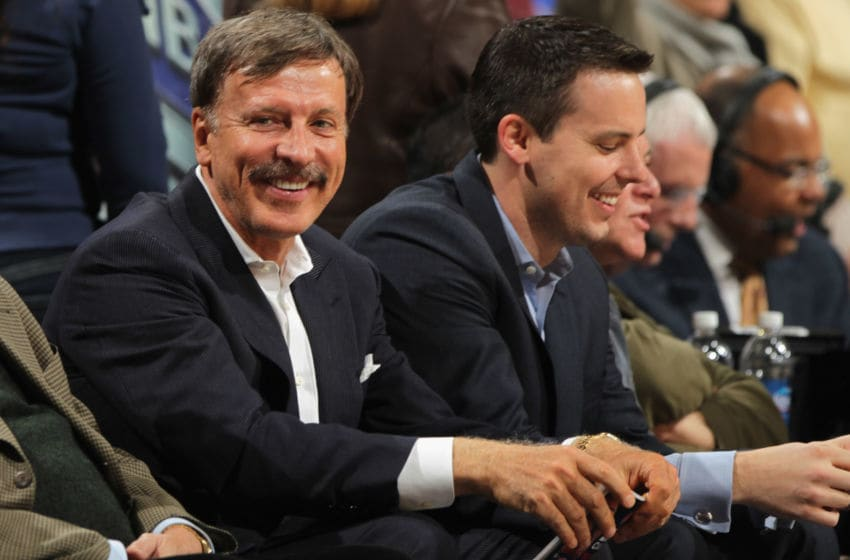 DENVER, CO - MARCH 23: Stan Kroenke (L) along with his son Josh Kroenke (R) watch from courtside seats as the Denver Nuggets host the San Antonio Spurs at the Pepsi Center on March 23, 2011 in Denver, Colorado. The Nuggets defeated the Spurs 115-112. NOTE TO USER: User expressly acknowledges and agrees that, by downloading and or using this photograph, User is consenting to the terms and conditions of the Getty Images License Agreement. (Photo by Doug Pensinger/Getty Images)