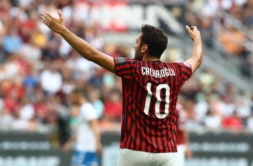 MILAN, ITALY - AUGUST 31: Hakan Calhanoglu of AC Milan gestures during the Serie A match between AC Milan and Brescia Calcio at Stadio Giuseppe Meazza on September 1, 2019 in Milan, Italy. (Photo by Marco Luzzani/Getty Images)