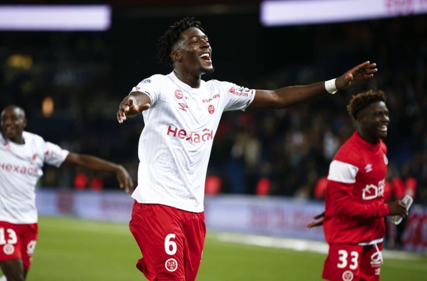 PARIS, FRANCE - SEPTEMBER 25: Axel Disasi #6 of Stade de Reims celebrates the victory of the Ligue 1 match between Paris Saint-Germain and Stade Reims at Parc des Princes on September 25, 2019 in Paris, France. (Photo by Catherine Steenkeste/Getty Images)