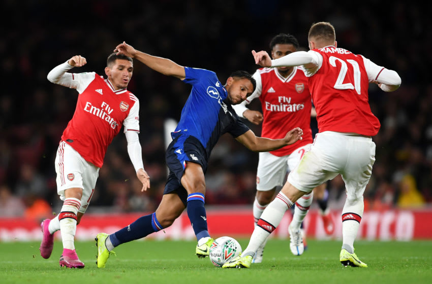 LONDON, ENGLAND - SEPTEMBER 24: Joao Carvalho of Nottingham Forest battles for the ball with Calum Chambers, Lucas Torreira and Reiss Nelson of Arsenal during the Carabao Cup Third Round match between Arsenal FC and Nottingham Forest at Emirates Stadium on September 24, 2019 in London, England. (Photo by Laurence Griffiths/Getty Images)