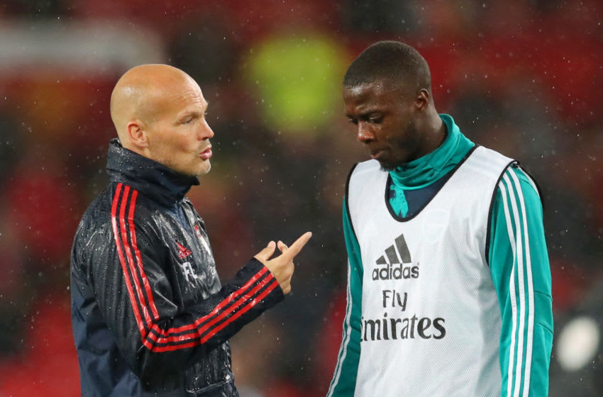 MANCHESTER, ENGLAND - SEPTEMBER 30: Freddie Ljungberg , Assistant Manager speaks with Nicolas Pepe of Arsenal during the warm up ahead of the Premier League match between Manchester United and Arsenal FC at Old Trafford on September 30, 2019 in Manchester, United Kingdom. (Photo by Catherine Ivill/Getty Images)