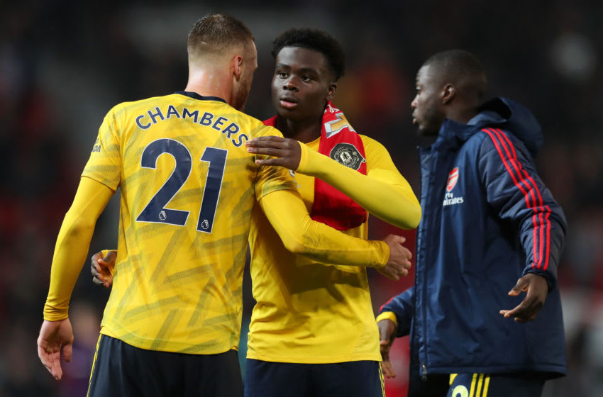 MANCHESTER, ENGLAND - SEPTEMBER 30: Bukayo Saka of Arsenal embraces Calum Chambers of Arsenal after the Premier League match between Manchester United and Arsenal FC at Old Trafford on September 30, 2019 in Manchester, United Kingdom. (Photo by Catherine Ivill/Getty Images)