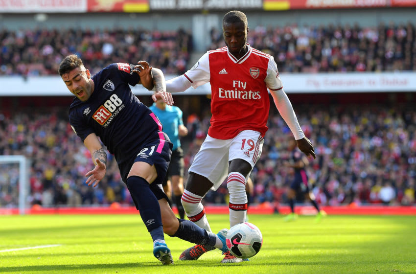 LONDON, ENGLAND - OCTOBER 06: Diego Rico of AFC Bournemouth is challenged by Nicolas Pepe of Arsenal during the Premier League match between Arsenal FC and AFC Bournemouth at Emirates Stadium on October 06, 2019 in London, United Kingdom. (Photo by Justin Setterfield/Getty Images)