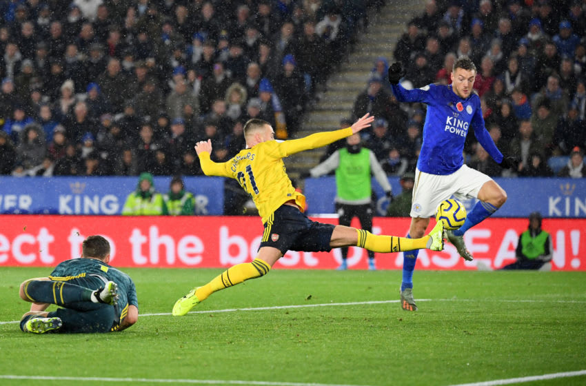 LEICESTER, ENGLAND - NOVEMBER 09: Calum Chambers of Arsenal stretches for the ball as Jamie Vardy of Leicester City attempts to shoot during the Premier League match between Leicester City and Arsenal FC at The King Power Stadium on November 09, 2019 in Leicester, United Kingdom. (Photo by Ross Kinnaird/Getty Images)