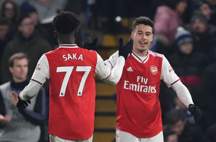 Arsenal's Brazilian striker Gabriel Martinelli (R) celebrates scoring their first goal to equalise 1-1 with Arsenal's English striker Bukayo Saka (L) during the English Premier League football match between Chelsea and Arsenal at Stamford Bridge in London on January 21, 2020. (Photo by DANIEL LEAL-OLIVAS / AFP) / RESTRICTED TO EDITORIAL USE. No use with unauthorized audio, video, data, fixture lists, club/league logos or 'live' services. Online in-match use limited to 120 images. An additional 40 images may be used in extra time. No video emulation. Social media in-match use limited to 120 images. An additional 40 images may be used in extra time. No use in betting publications, games or single club/league/player publications. / (Photo by DANIEL LEAL-OLIVAS/AFP via Getty Images)