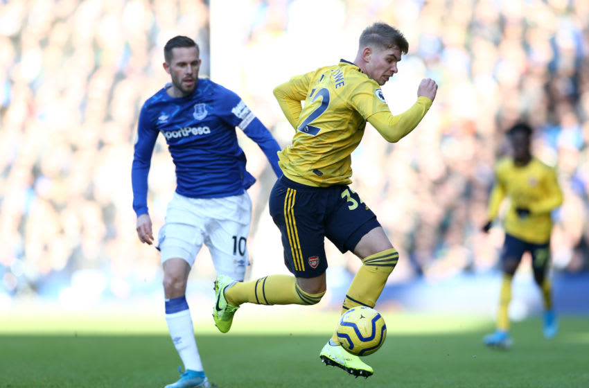 LIVERPOOL, ENGLAND - DECEMBER 21: Emile Smith Rowe of Arsenal battles for possession with Gylfi Sigurdsson of Everton during the Premier League match between Everton FC and Arsenal FC at Goodison Park on December 21, 2019 in Liverpool, United Kingdom. (Photo by Jan Kruger/Getty Images)