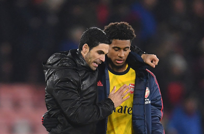 BOURNEMOUTH, ENGLAND - DECEMBER 26: Mikel Arteta, Manager of Arsenal speaks to Reiss Nelson of Arsenal following their draw in the Premier League match between AFC Bournemouth and Arsenal FC at Vitality Stadium on December 26, 2019 in Bournemouth, United Kingdom. (Photo by Justin Setterfield/Getty Images)