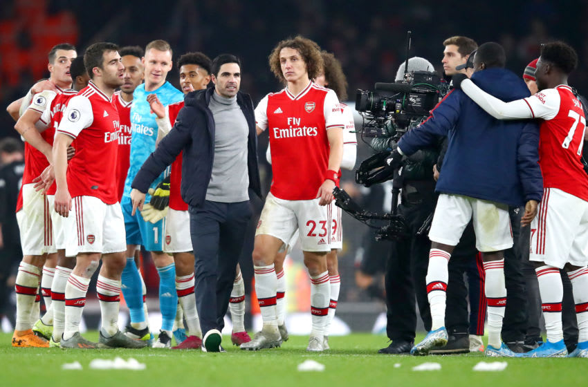 LONDON, ENGLAND - JANUARY 01: Mikel Arteta, Manager of Arsenal celebrates victory with David Luiz after the Premier League match between Arsenal FC and Manchester United at Emirates Stadium on January 01, 2020 in London, United Kingdom. (Photo by Julian Finney/Getty Images)