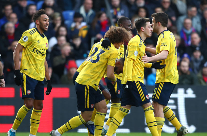 LONDON, ENGLAND - JANUARY 11: Pierre-Emerick Aubameyang of Arsenal celebrates with teammates after scoring his team's first goal during the Premier League match between Crystal Palace and Arsenal FC at Selhurst Park on January 11, 2020 in London, United Kingdom. (Photo by Dan Istitene/Getty Images)