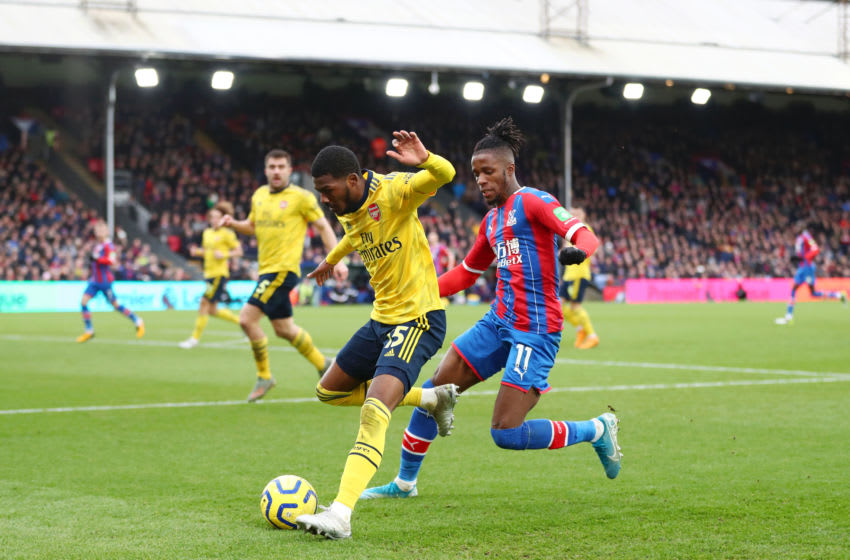 LONDON, ENGLAND - JANUARY 11: Ainsley Maitland-Niles of Arsenal battles for possession with Wilfried Zaha of Crystal Palace during the Premier League match between Crystal Palace and Arsenal FC at Selhurst Park on January 11, 2020 in London, United Kingdom. (Photo by Dan Istitene/Getty Images)