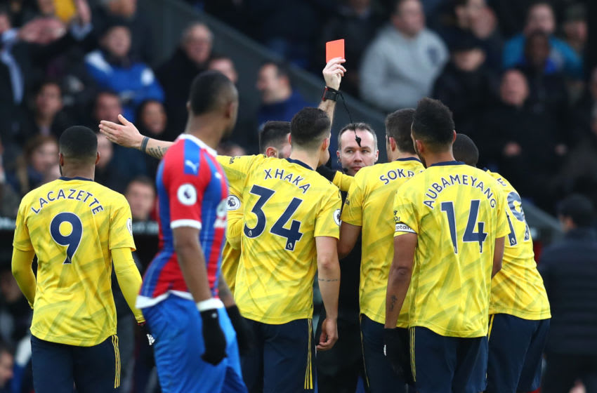 LONDON, ENGLAND - JANUARY 11: Referee Paul Tierney shows a red card to Pierre-Emerick Aubameyang of Arsenal during the Premier League match between Crystal Palace and Arsenal FC at Selhurst Park on January 11, 2020 in London, United Kingdom. (Photo by Dan Istitene/Getty Images)