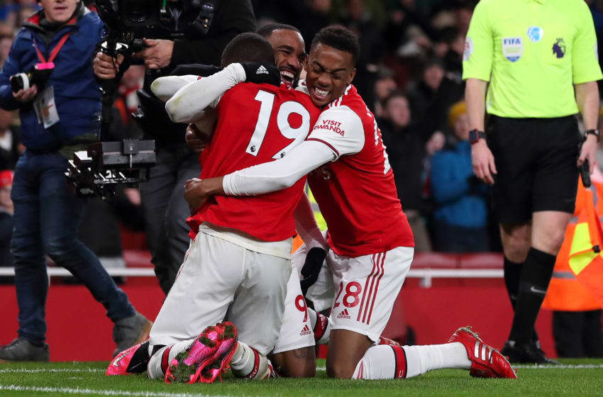LONDON, ENGLAND - FEBRUARY 16: Alexandre Lacazette of Arsenal celebrates after scoring a goal to make it 4-0 with Nicolas Pepe and Joe Willock during the Premier League match between Arsenal FC and Newcastle United at Emirates Stadium on February 16, 2020 in London, United Kingdom. (Photo by James Williamson - AMA/Getty Images)