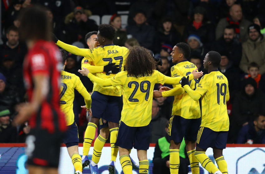 BOURNEMOUTH, ENGLAND - JANUARY 27: Bukayo Saka of Arsenal celebrates with teammates after scoring his team's first goal during the FA Cup Fourth Round match between AFC Bournemouth and Arsenal at Vitality Stadium on January 27, 2020 in Bournemouth, England. (Photo by Warren Little/Getty Images)