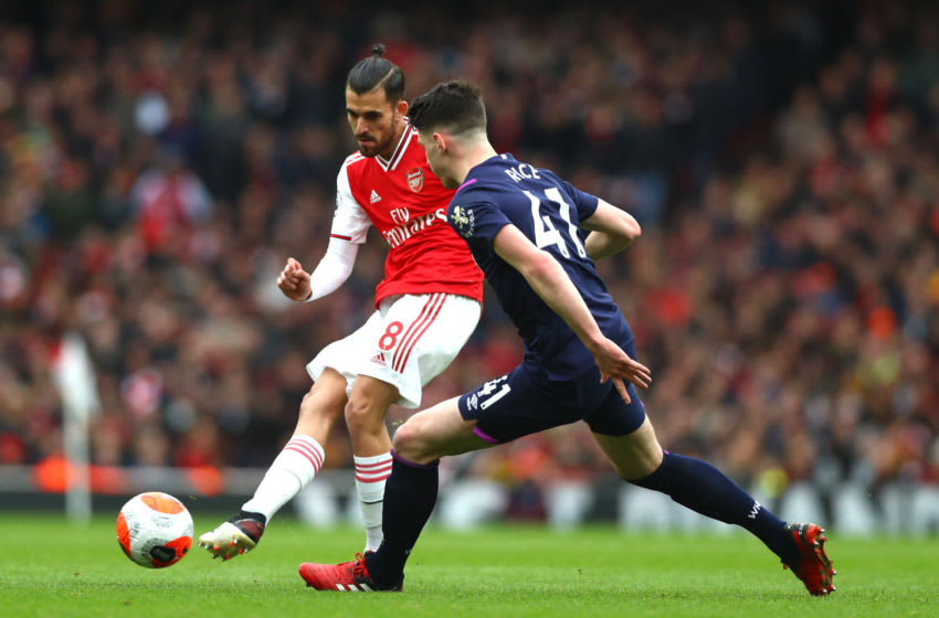LONDON, ENGLAND - MARCH 07: Dani Ceballos of Arsenal and Declan Rice of West Ham United in action during the Premier League match between Arsenal FC and West Ham United at Emirates Stadium on March 07, 2020 in London, United Kingdom. (Photo by Chloe Knott - Danehouse/Getty Images)