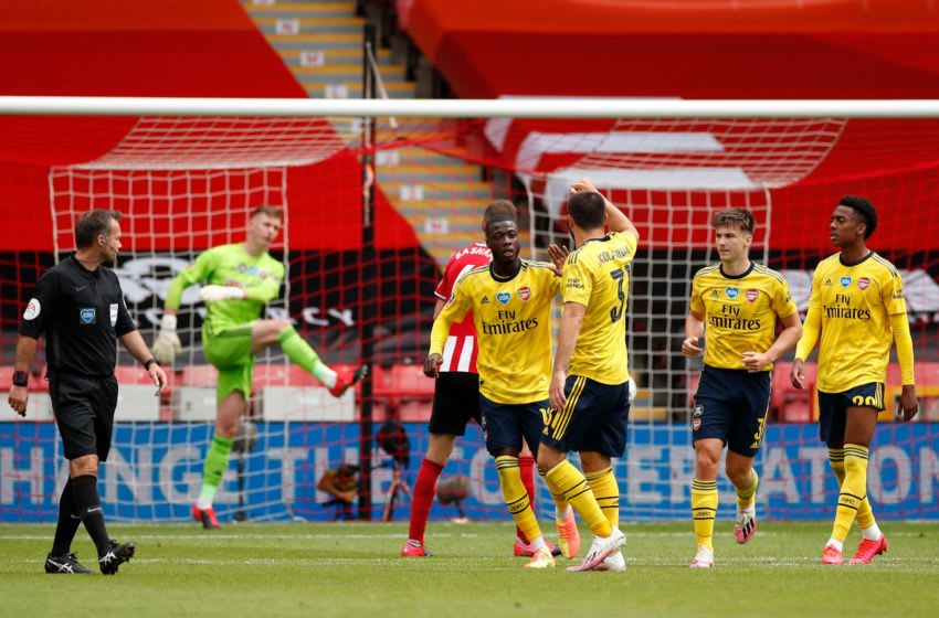 Arsenal's players celebrate after Nicolas Pepe scored the opening goal from a penalty during the English FA Cup quarter-final football match between Sheffield United and Arsenal at Bramall Lane in Sheffield, northern England on June 28, 2020. (Photo by ANDREW BOYERS / POOL / AFP) / RESTRICTED TO EDITORIAL USE. No use with unauthorized audio, video, data, fixture lists, club/league logos or 'live' services. Online in-match use limited to 120 images. An additional 40 images may be used in extra time. No video emulation. Social media in-match use limited to 120 images. An additional 40 images may be used in extra time. No use in betting publications, games or single club/league/player publications. / (Photo by ANDREW BOYERS/POOL/AFP via Getty Images)
