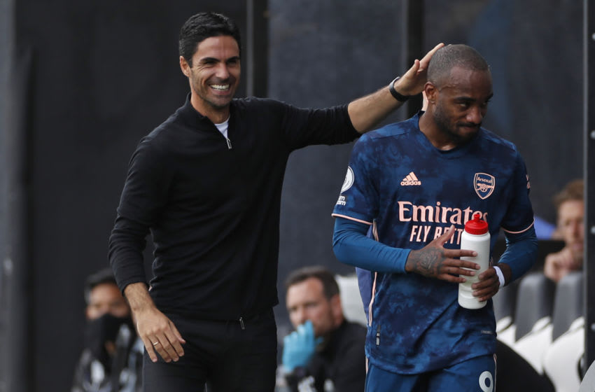 Arsenal's Spanish first-team manager Mikel Arteta (L) congratulates Arsenal's French striker Alexandre Lacazette (R) after the latter was substituted during the English Premier League football match between Fulham and Arsenal at Craven Cottage in London on September 12, 2020. (Photo by PAUL CHILDS / POOL / AFP) / RESTRICTED TO EDITORIAL USE. No use with unauthorized audio, video, data, fixture lists, club/league logos or 'live' services. Online in-match use limited to 120 images. An additional 40 images may be used in extra time. No video emulation. Social media in-match use limited to 120 images. An additional 40 images may be used in extra time. No use in betting publications, games or single club/league/player publications. / (Photo by PAUL CHILDS/POOL/AFP via Getty Images)