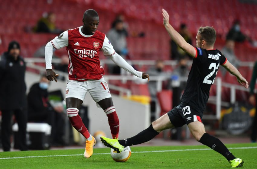 Arsenal's French-born Ivorian midfielder Nicolas Pepe (L) vies with Dundalk's Northern Irish defender Cameron Dummigan during the UEFA Europa League 1st round day 2 Group B football match between Arsenal and Dundalk at the Emirates Stadium in London on October 29, 2020. (Photo by Glyn KIRK / AFP) (Photo by GLYN KIRK/AFP via Getty Images)