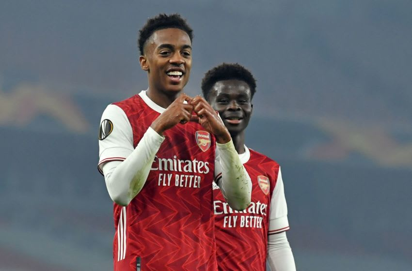 Arsenal's English midfielder Joe Willock (L) celebrates scoring his team's fourth goal during the UEFA Europa League Group B football match between Arsenal and Molde at the Emirates Stadium in London on November 5, 2020. - Arsenal won the game 4-1. (Photo by Glyn KIRK / AFP) (Photo by GLYN KIRK/AFP via Getty Images)