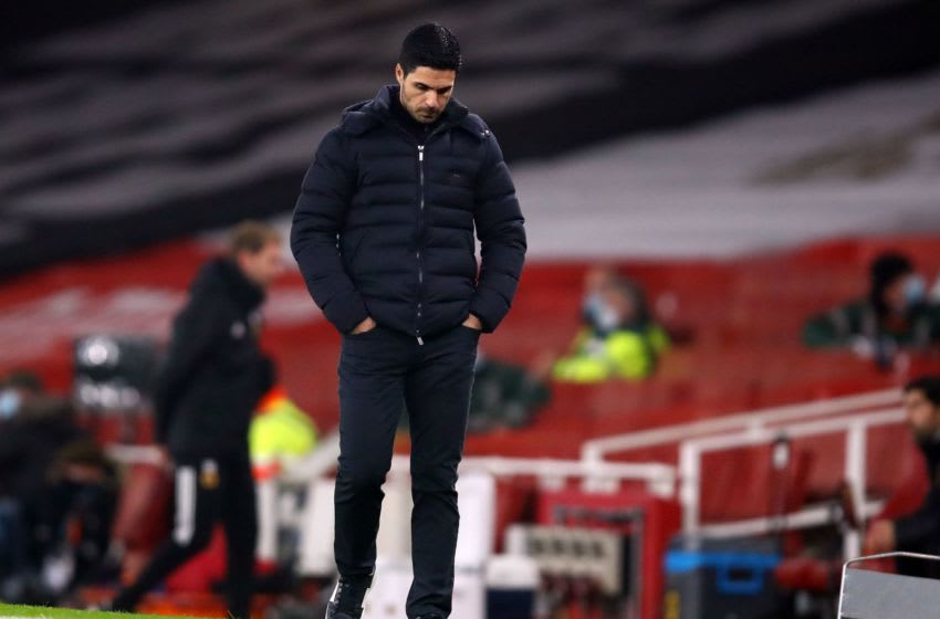 Arsenal's Spanish manager Mikel Arteta reacts during the English Premier League football match between Arsenal and Wolverhampton Wanderers at the Emirates Stadium in London on November 29, 2020. (Photo by Julian Finney / POOL / AFP) / RESTRICTED TO EDITORIAL USE. No use with unauthorized audio, video, data, fixture lists, club/league logos or 'live' services. Online in-match use limited to 120 images. An additional 40 images may be used in extra time. No video emulation. Social media in-match use limited to 120 images. An additional 40 images may be used in extra time. No use in betting publications, games or single club/league/player publications. / (Photo by JULIAN FINNEY/POOL/AFP via Getty Images)