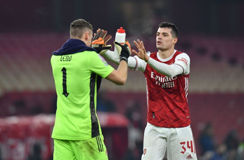Arsenal's Swiss midfielder Granit Xhaka and Arsenal's German goalkeeper Bernd Leno celebrates after the English FA Cup third round football match between Arsenal and Newcastle United at the Emirates Stadium in London on January 9, 2021. - Arsenal won the game 2-0 aet. (Photo by Glyn KIRK / AFP) / RESTRICTED TO EDITORIAL USE. No use with unauthorized audio, video, data, fixture lists, club/league logos or 'live' services. Online in-match use limited to 120 images. An additional 40 images may be used in extra time. No video emulation. Social media in-match use limited to 120 images. An additional 40 images may be used in extra time. No use in betting publications, games or single club/league/player publications. / (Photo by GLYN KIRK/AFP via Getty Images)