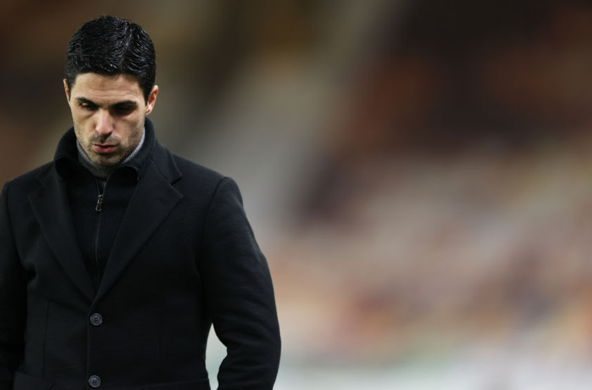 WOLVERHAMPTON, ENGLAND - FEBRUARY 02: A dejected Mikel Arteta the manager / head coach of Arsenal during the Premier League match between Wolverhampton Wanderers and Arsenal at Molineux on February 2, 2021 in Wolverhampton, United Kingdom. Sporting stadiums around the UK remain under strict restrictions due to the Coronavirus Pandemic as Government social distancing laws prohibit fans inside venues resulting in games being played behind closed doors. (Photo by Matthew Ashton - AMA/Getty Images)