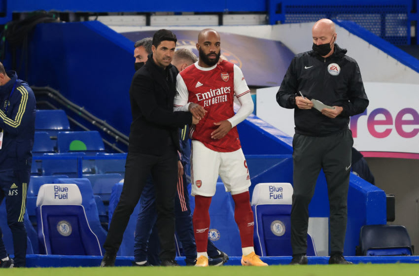 LONDON, ENGLAND - MAY 12: Mikel Arteta manager of Arsenal with Alexandre Lacazette during the Premier League match between Chelsea and Arsenal at Stamford Bridge on May 12, 2021 in London, United Kingdom. (Photo by Marc Atkins/Getty Images)