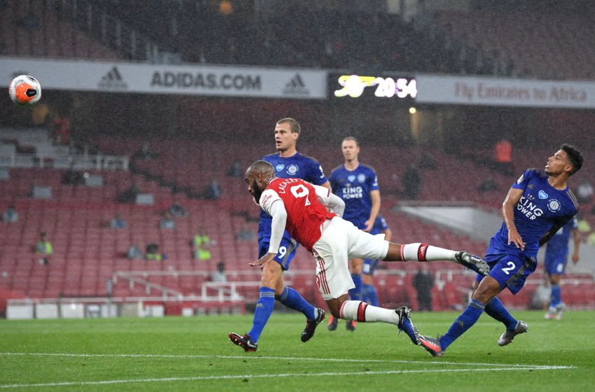 LONDON, ENGLAND - JULY 07: Alexandre Lacazette of Arsenal jumps for a header during the Premier League match between Arsenal FC and Leicester City at Emirates Stadium on July 07, 2020 in London, England. Football Stadiums around Europe remain empty due to the Coronavirus Pandemic as Government social distancing laws prohibit fans inside venues resulting in all fixtures being played behind closed doors. (Photo by Michael Regan/Getty Images)
