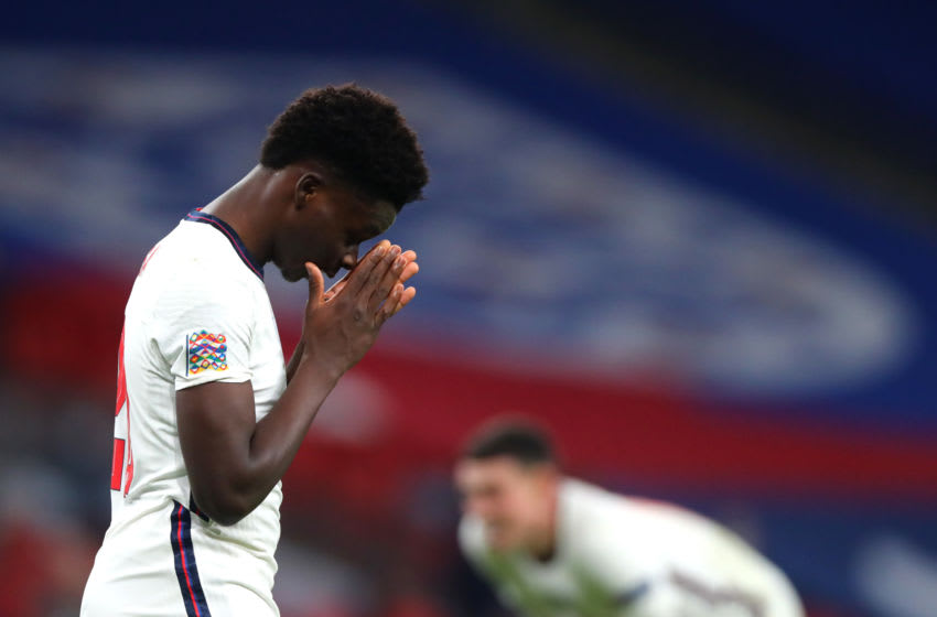 LONDON, ENGLAND - NOVEMBER 18: Bukayo Saka of England reacts during the UEFA Nations League group stage match between England and Iceland at Wembley Stadium on November 18, 2020 in London, England. Football Stadiums around Europe remain empty due to the Coronavirus Pandemic as Government social distancing laws prohibit fans inside venues resulting in fixtures being played behind closed doors. (Photo by Chloe Knott - Danehouse/Getty Images)