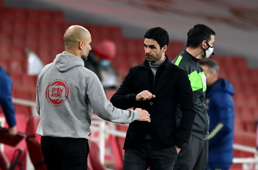 LONDON, ENGLAND - FEBRUARY 21: Pep Guardiola, Manager of Manchester City bumps fists with Mikel Arteta, Manager of Arsenal after the Premier League match between Arsenal and Manchester City at Emirates Stadium on February 21, 2021 in London, England. Sporting stadiums around the UK remain under strict restrictions due to the Coronavirus Pandemic as Government social distancing laws prohibit fans inside venues resulting in games being played behind closed doors. (Photo by Shaun Botterill/Getty Images)
