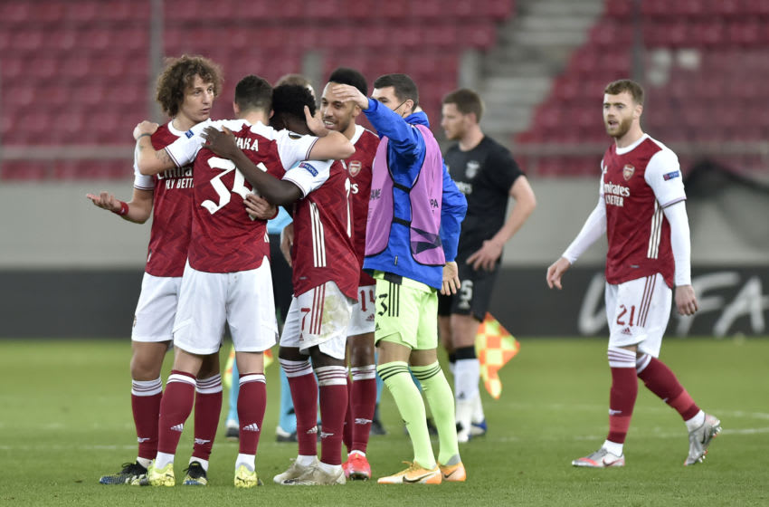 PIRAEUS, GREECE - FEBRUARY 25: David Luiz, Granit Xhaka Bukayo Saka, Pierre-Emerick Aubameyang and Mat Ryan of Arsenal celebrate following their team's victory in the UEFA Europa League Round of 32 match between Arsenal FC and SL Benfica at Karaiskakis Stadium on February 25, 2021 in Piraeus, Greece. Arsenal face SL Benfica at a neutral venue in Piraeus behind closed doors to prevent the spread of Covid-19 variants. (Photo by Milos Bicanski/Getty Images)