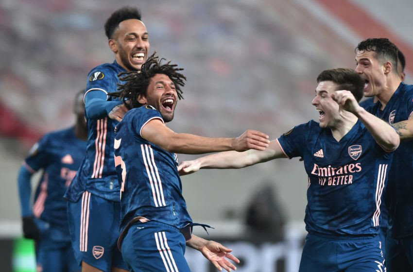 PIRAEUS, GREECE - MARCH 11: Mohamed Elneny of Arsenal celebrates with team mates Kieran Tierney and Pierre-Emerick Aubameyang after scoring their side's third goal during the UEFA Europa League Round of 16 First Leg match between Olympiacos and Arsenal at Karaiskakis Stadium on March 11, 2021 in Piraeus, Greece. Sporting stadiums around Europe remain under strict restrictions due to the Coronavirus Pandemic as Government social distancing laws prohibit fans inside venues resulting in games being played behind closed doors. (Photo by Milos Bicanski/Getty Images)