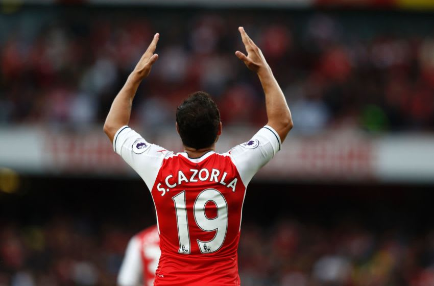Arsenal's Spanish midfielder Santi Cazorla gestures during the English Premier League football match between Arsenal and Southampton at the Emirates Stadium in London on September 10, 2016. Arsenal won the game 2-1. / AFP / Adrian DENNIS / RESTRICTED TO EDITORIAL USE. No use with unauthorized audio, video, data, fixture lists, club/league logos or 'live' services. Online in-match use limited to 75 images, no video emulation. No use in betting, games or single club/league/player publications. / (Photo credit should read ADRIAN DENNIS/AFP via Getty Images)