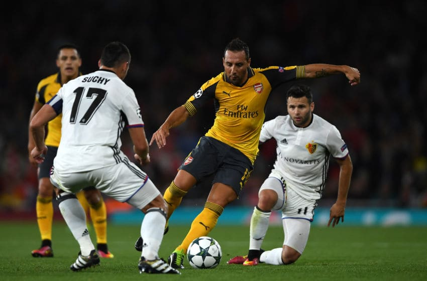 LONDON, ENGLAND - SEPTEMBER 28: Santi Cazorla of Arsenal battles for the ball with Marek Suchy and Renato Steffen of Basel during the UEFA Champions League group A match between Arsenal FC and FC Basel 1893 at the Emirates Stadium on September 28, 2016 in London, England. (Photo by Mike Hewitt/Getty Images)