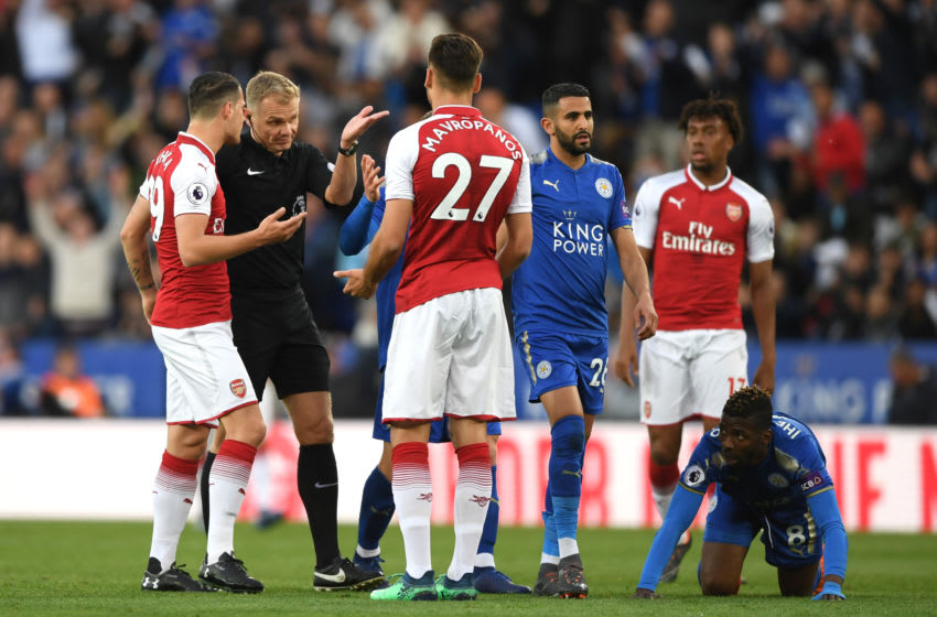 LEICESTER, ENGLAND - MAY 09: Granit Xhaka of Arsenal speaks with referee Graham Scott as Konstantinos Mavropanos of Arsenal appeals his innocent during the Premier League match between Leicester City and Arsenal at The King Power Stadium on May 9, 2018 in Leicester, England. (Photo by Shaun Botterill/Getty Images)