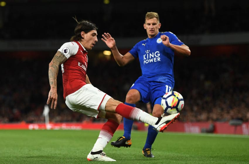 LONDON, ENGLAND - AUGUST 11: Hector Bellerin of Arsenal clears the ball as Marc Albrighton of Leicester City closes in during the Premier League match between Arsenal and Leicester City at the Emirates Stadium on August 11, 2017 in London, England. (Photo by Michael Regan/Getty Images)