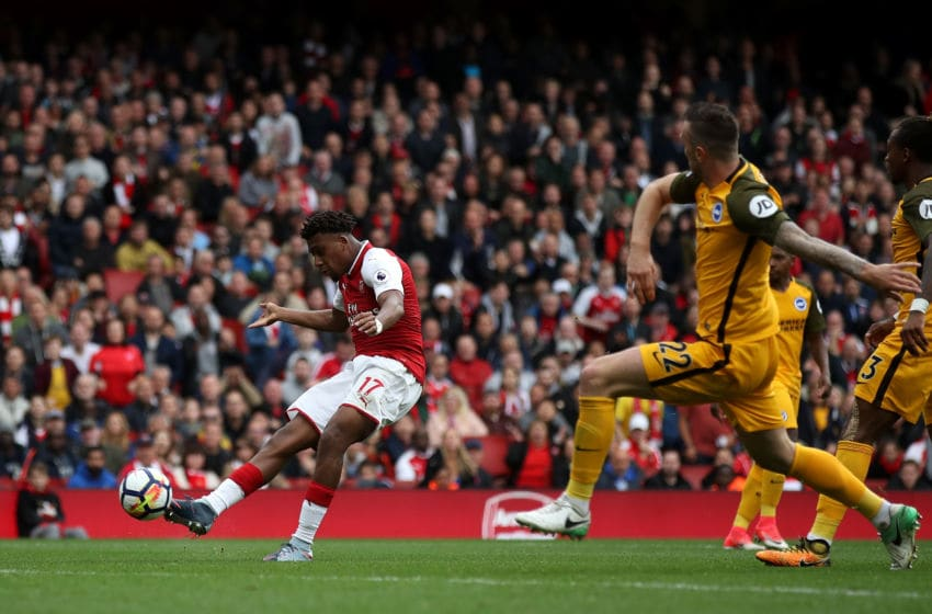 LONDON, ENGLAND - OCTOBER 01: Alex Iwobi of Arsenal scores his sides second goal as Shane Duffy of Brighton and Hove Albion attempts to block during the Premier League match between Arsenal and Brighton and Hove Albion at Emirates Stadium on October 1, 2017 in London, England. (Photo by Julian Finney/Getty Images)