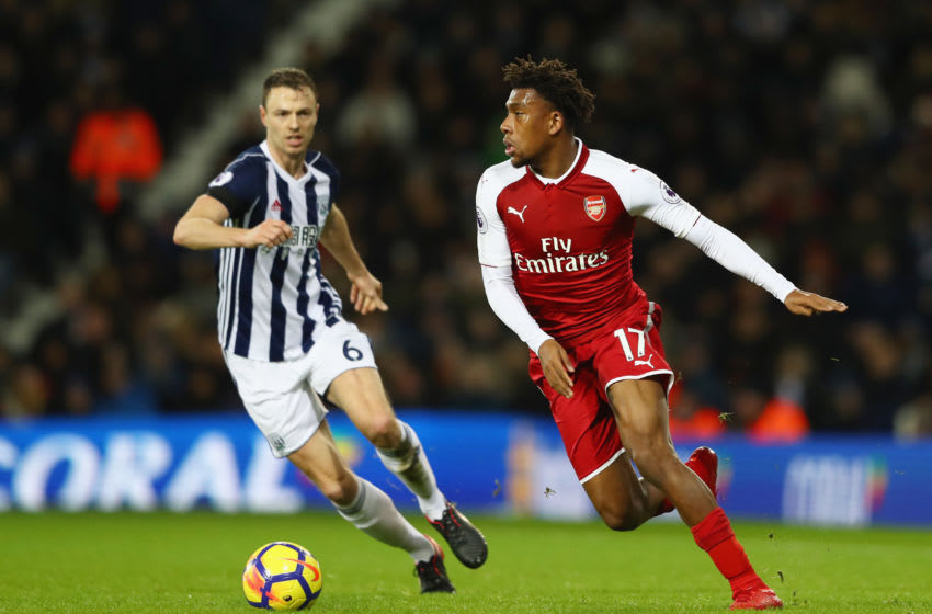 WEST BROMWICH, ENGLAND - DECEMBER 31: Alex Iwobi of Arsenal is watched by Jonny Evans of West Bromwich Albion during the Premier League match between West Bromwich Albion and Arsenal at The Hawthorns on December 31, 2017 in West Bromwich, England. (Photo by Michael Steele/Getty Images)