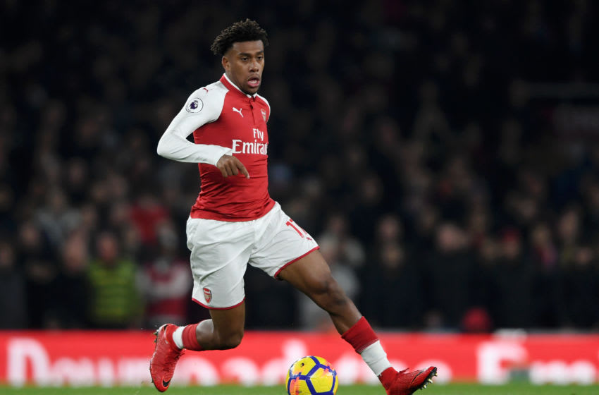 LONDON, ENGLAND - DECEMBER 02: Alex Iwobi of Arsenal runs with the ball during the Premier League match between Arsenal and Manchester United at Emirates Stadium on December 2, 2017 in London, England. (Photo by Laurence Griffiths/Getty Images)