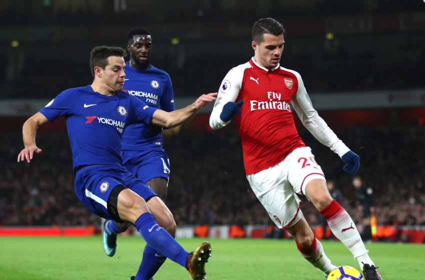 LONDON, ENGLAND - JANUARY 03: Granit Xhaka of Arsenal in action as Cesar Azpilicueta of Chelsea chases during the Premier League match between Arsenal and Chelsea at Emirates Stadium on January 3, 2018 in London, England. (Photo by Julian Finney/Getty Images)