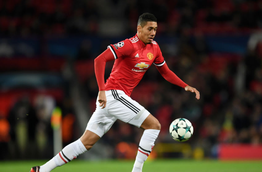 MANCHESTER, ENGLAND - DECEMBER 05: Chris Smalling of Manchester United runs with the ball during the UEFA Champions League group A match between Manchester United and CSKA Moskva at Old Trafford on December 05, 2017 in Manchester, United Kingdom. (Photo by Laurence Griffiths/Getty Images)