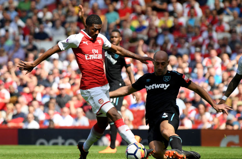 LONDON, ENGLAND - APRIL 22: Ainsley Maitland-Niles of Arsenal and Pablo Zabaleta of West Ham United during the Premier League match between Arsenal and West Ham United at Emirates Stadium on April 22, 2018 in London, England. (Photo by Mike Hewitt/Getty Images)