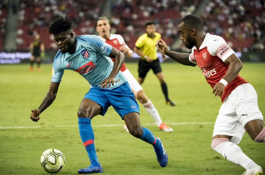 SINGAPORE,SINGAPORE - JULY 26: Thomas Partey of Club Atletico de Madrid battles for the ball with Alexandre Lacazette of Arsenal during the International Champions Cup 2018 match between Arsenal and Club Atletico de Madrid (Photo by PictoBank/Getty Images)