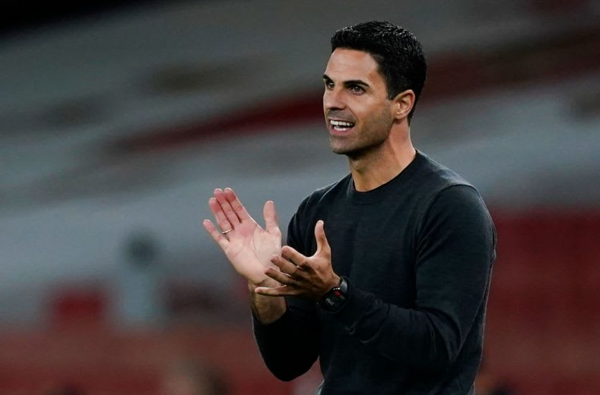Arsenal's Spanish manager Mikel Arteta reacts on the touchline during the English Premier League football match between Arsenal and West Ham United at the Emirates Stadium in London on September 19, 2020. (Photo by Will Oliver / POOL / AFP) / RESTRICTED TO EDITORIAL USE. No use with unauthorized audio, video, data, fixture lists, club/league logos or 'live' services. Online in-match use limited to 120 images. An additional 40 images may be used in extra time. No video emulation. Social media in-match use limited to 120 images. An additional 40 images may be used in extra time. No use in betting publications, games or single club/league/player publications. / (Photo by WILL OLIVER/POOL/AFP via Getty Images)