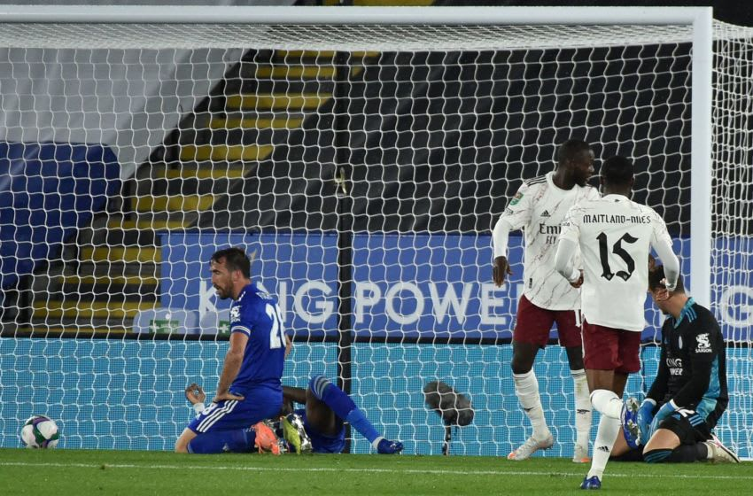 Leicester City's Austrian defender Christian Fuchs (L) reacts after scoring an own goal during the English League Cup third round football match between Leicester City and Arsenal at King Power Stadium in Leicester, central England on September 23, 2020. (Photo by Rui Vieira / POOL / AFP) / RESTRICTED TO EDITORIAL USE. No use with unauthorized audio, video, data, fixture lists, club/league logos or 'live' services. Online in-match use limited to 120 images. An additional 40 images may be used in extra time. No video emulation. Social media in-match use limited to 120 images. An additional 40 images may be used in extra time. No use in betting publications, games or single club/league/player publications. / (Photo by RUI VIEIRA/POOL/AFP via Getty Images)