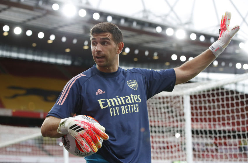 LONDON, ENGLAND - JULY 15: Emiliano Martinez of Arsenal warms up ahead of the Premier League match between Arsenal FC and Liverpool FC at Emirates Stadium on July 15, 2020 in London, England. Football Stadiums around Europe remain empty due to the Coronavirus Pandemic as Government social distancing laws prohibit fans inside venues resulting in all fixtures being played behind closed doors. (Photo by Paul Childs/Pool via Getty Images)