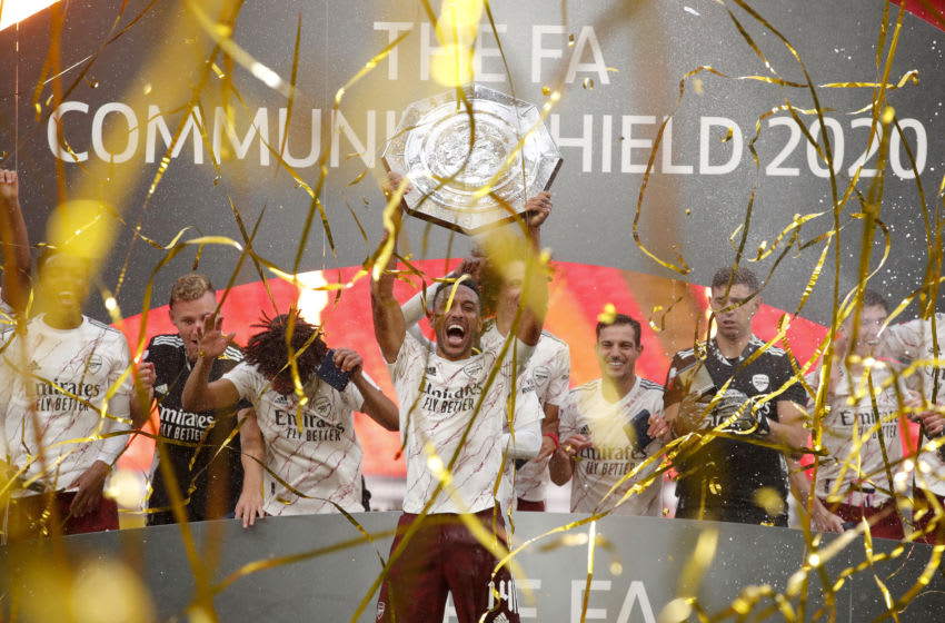 LONDON, ENGLAND - AUGUST 29: Pierre-Emerick Aubameyang of Arsenal lifts the Community Shield Trophy following his team's victory in during the FA Community Shield final between Arsenal and Liverpool at Wembley Stadium on August 29, 2020 in London, England. (Photo by Andrew Couldridge/Pool via Getty Images)