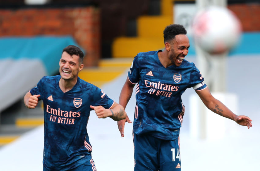 LONDON, ENGLAND - SEPTEMBER 12: Pierre-Emerick Aubameyang of Arsenal celebrates with Granita Xhaka after scoring his team's third goal during the Premier League match between Fulham and Arsenal at Craven Cottage on September 12, 2020 in London, England. (Photo by Clive Rose/Getty Images)