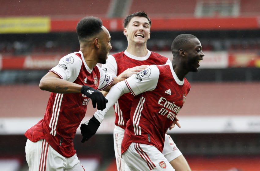 LONDON, ENGLAND - OCTOBER 04: Nicolas Pepe of Arsenal celebrates with teammates after scoring his team's second goal during the Premier League match between Arsenal and Sheffield United at Emirates Stadium on October 04, 2020 in London, England. Sporting stadiums around the UK remain under strict restrictions due to the Coronavirus Pandemic as Government social distancing laws prohibit fans inside venues resulting in games being played behind closed doors. (Photo by Kirsty Wigglesworth - Pool/Getty Images)
