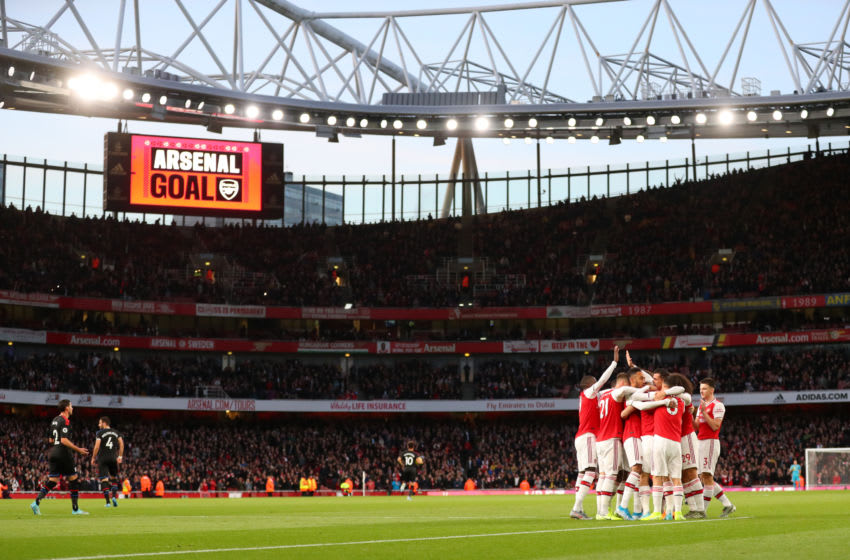 LONDON, ENGLAND - OCTOBER 27: A general view as Sokratis Papastathopoulos of Arsenal celebrates with team mates after scoring their team's first goal during the Premier League match between Arsenal FC and Crystal Palace at Emirates Stadium on October 27, 2019 in London, United Kingdom. (Photo by Catherine Ivill/Getty Images)